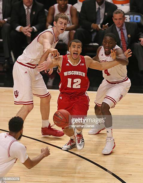 Treavon Jackson of the Wisconsin Badgers tries to drive between Cody Zeller and Victor Oladipo of the Indiana Hoosiers during a semifinal game of the...