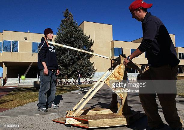 Trebuchet time at the University of Denver First year engineering students freshman Phil Spinner and Steven Binkley watch their trebuchet launch a...