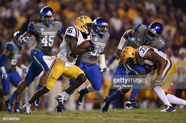 Tre'Davious White of the LSU Tigers returns a punt for a touchdown during the first quarter of a game against the Kentucky Wildcats at Tiger Stadium...