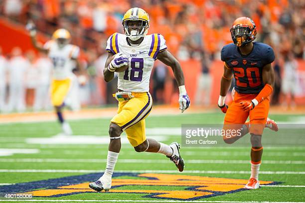 Tre'Davious White of the LSU Tigers returns a punt for a touchdown to make the score 173 during the second half against the Syracuse Orange on...