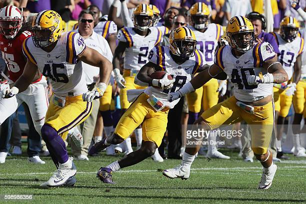 Tre'Davious White of the LSU Tigers returns an interception for a touchdown during the third quarter against the Wisconsin Badgers at Lambeau Field...