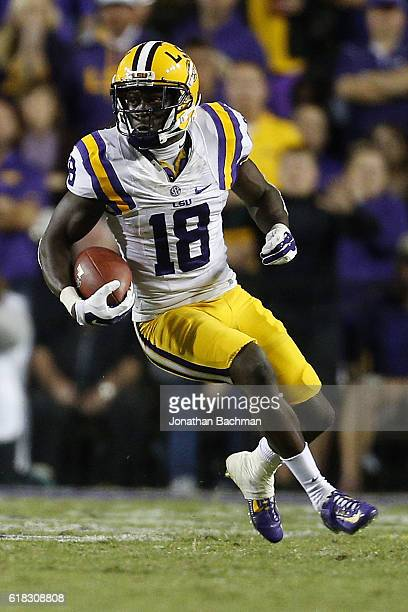 Tre'Davious White of the LSU Tigers runs with the ball during a game against the Mississippi Rebels at Tiger Stadium on October 22 2016 in Baton...
