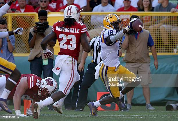 Tre'Davious White of the LSU Tigers scores a touchdown after making an interception in the third quarter against the Wisconsin Badgers at Lambeau...