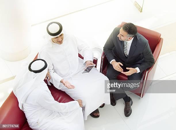 Tree arab businessmen in meeting, with tablet