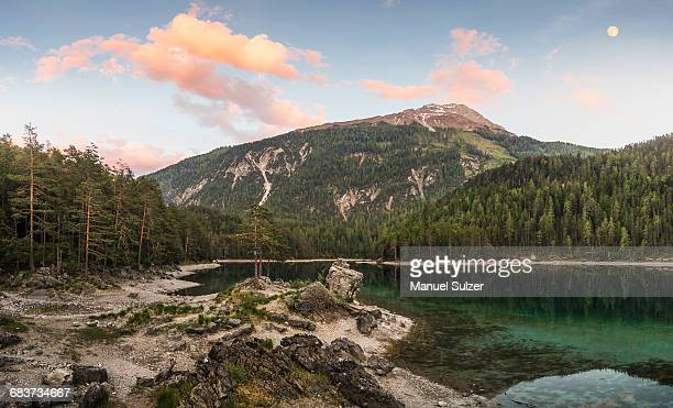 Tree covered mountains by river, Leermoos, Tyrol, Austria