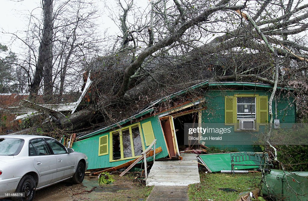 A tree crushed this house on Mable Street in Hattiesburg, Mississippi, when a tornado hit the area on Sunday, February 10, 2013. An EF-4 tornado hit the area according to a preliminary report from the National Weather Service in Jackson. Sixty-three people were injured in the storm.
