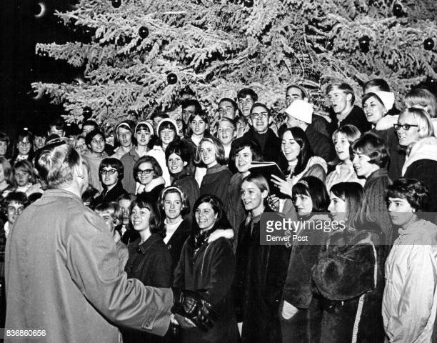 Tree Heralds Christmas Carols sung under the giant Christmas tree at University Hills Shopping Center 2700 S Colorado Blvd brightened the Christmas...