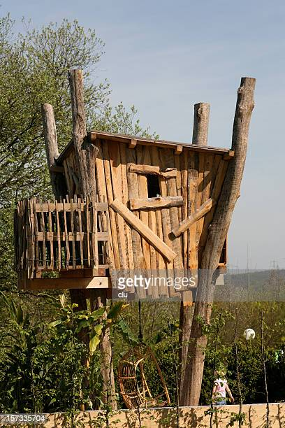Tree house with rockingchair underneath