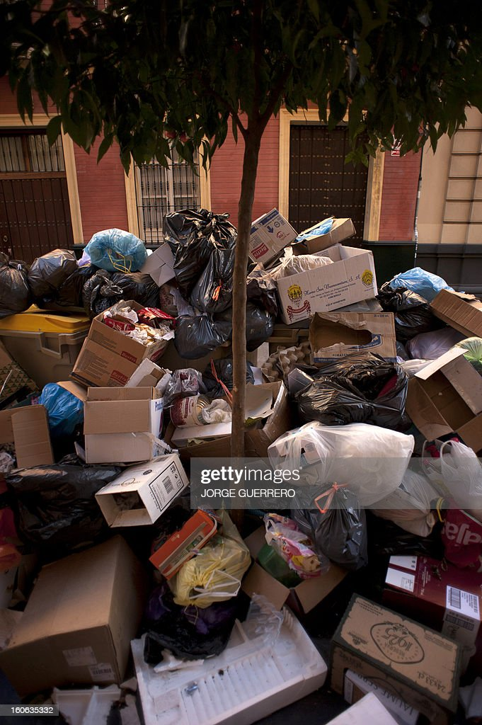 A tree is surrounded by uncollected rubbish on a square of Sevilla on February 4, 2013. Rubbish collectors have been on strike in the municipality of Sevilla to protest against the austerity cuts imposed by the town hall.
