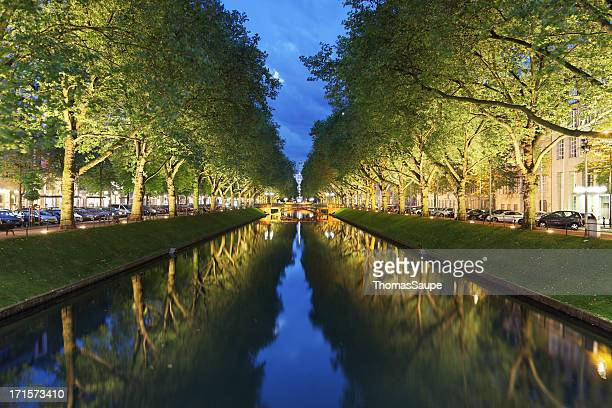 Tree lined Konigsallee in Dusseldorf in the evening