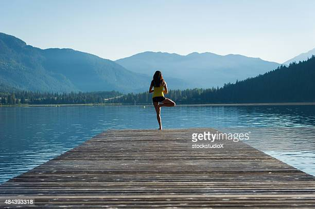 Tree Pose Tranquil Lakeside meditation at sunrise