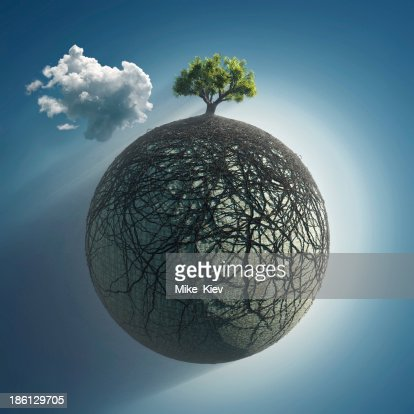 tree roots covering the planet : Stock Photo