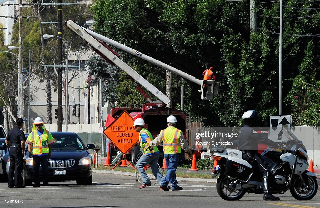 Tree trimmers cut down large branches of a tree that was protruding toward the street in a last-minute effort to clear hurdles along the route of the space shuttle Endeavour's as it journey's through the streets of Los Angeles County on October 12, 2012 in Los Angeles, California. The space shuttle Endeavour is making the journey from Los Angeles International Airport to the California Science Center to go on permanent public display. Endeavour was transported cross-country atop NASA's Shuttle Carrier Aircraft from Kennedy Space Center in Florida to LAX during its last flight ever on September 21.