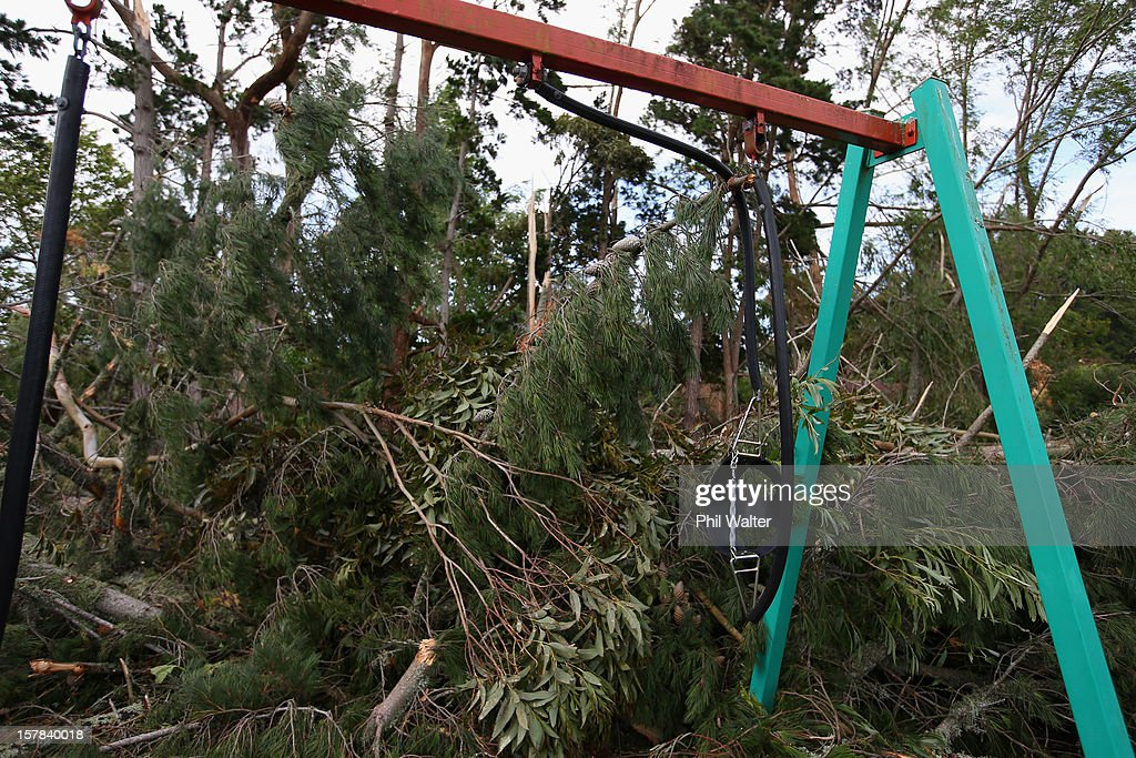 Trees and storm debri litter a playground in the Auckland suburb of Whenuapai following a tornado that struck yesterday on December 7, 2012 in Auckland, New Zealand. Police today named the three men killed whilst working on a construction site when the tornado hit.