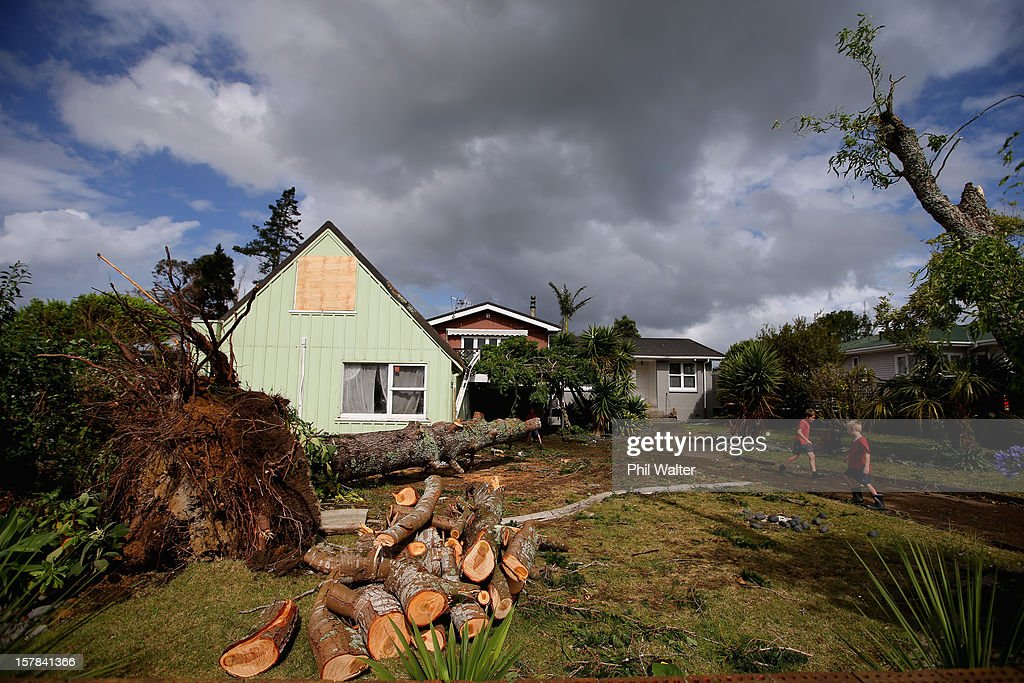Trees and storm debri litter homes in the Auckland suburb of Whenuapai following a tornado that struck yesterday on December 7, 2012 in Auckland, New Zealand. Police today named the three men killed whilst working on a construction site when the tornado hit.