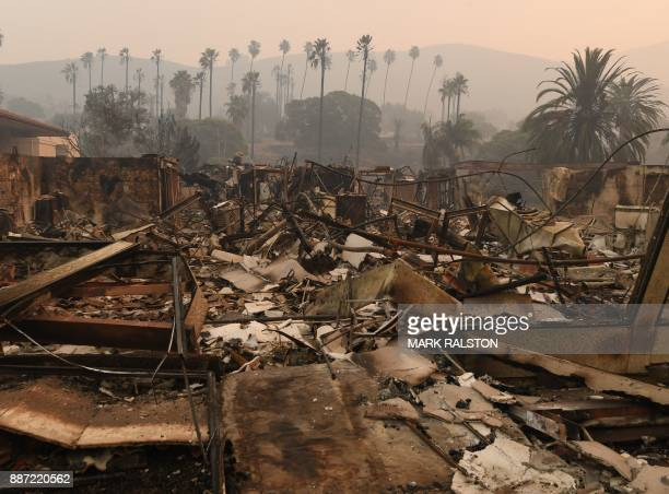 TOPSHOT Trees are seen through the haze at the burnt out Vista del Mar Hospital after the Thomas wildfire swept through Ventura California on...