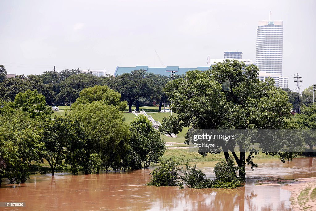 Trees are submerged at Buffalo Bayou park after massive flooding May 27 2015 in Houston Texas At least 19 people have been killed across Texas and...