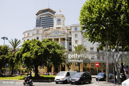 Trees in front of a building, Barcelona, Spain : Stock Photo
