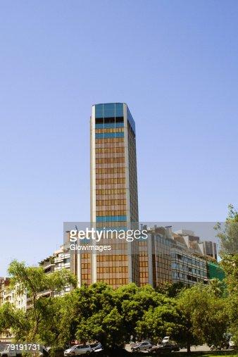 Trees in front of buildings, Barcelona, Spain : Foto de stock