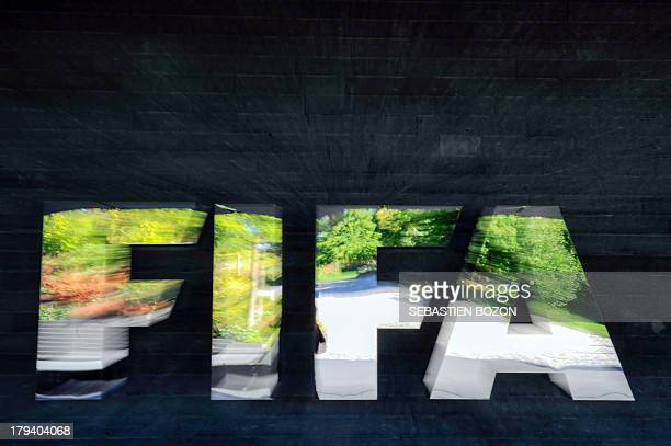 Trees reflect on September 3 2013 in the logo of the FIFA outside its headquarters in Zurich AFP PHOTO / SEBASTIEN BOZON