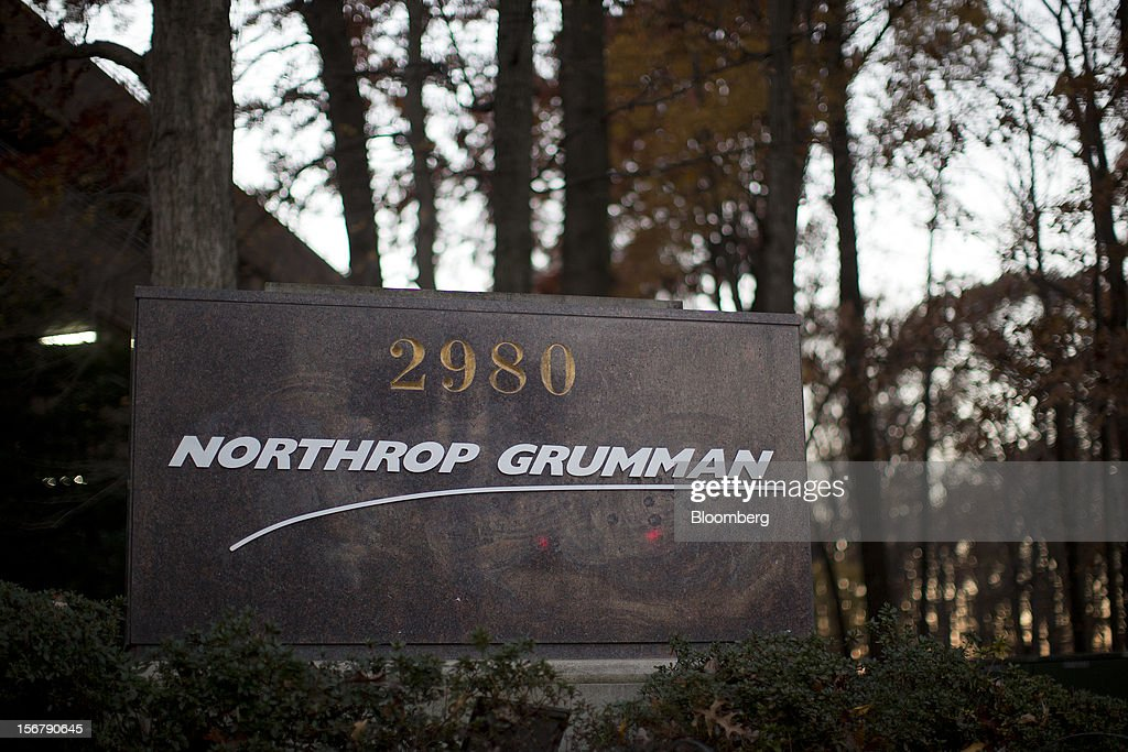 Trees stand behind a Northrop Grumman Corp. sign outside the company's headquarters in Falls Church, Virginia, U.S., on Friday, Nov. 16, 2012. President Barack Obama expressed confidence that he and Congress would reach an agreement that will avoid the automatic spending cuts and tax increases that are scheduled to occur at the end of the year. The fiscal cliff is the $607 billion combination of automatic spending cuts and tax increases scheduled to take effect in January. Lawmakers are trying to avert the cliff to prevent a short-term shock to the economy and reach an agreement on long-term deficit reduction. Photographer: Andrew Harrer/Bloomberg via Getty Images