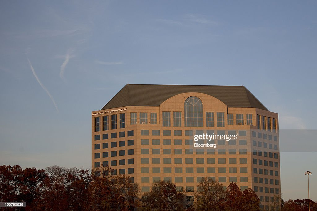 Trees stand in front of the Northrop Grumman Corp. headquarters stands in Falls Church, Virginia, U.S., on Friday, Nov. 16, 2012. President Barack Obama expressed confidence that he and Congress would reach an agreement that will avoid the automatic spending cuts and tax increases that are scheduled to occur at the end of the year. The fiscal cliff is the $607 billion combination of automatic spending cuts and tax increases scheduled to take effect in January. Lawmakers are trying to avert the cliff to prevent a short-term shock to the economy and reach an agreement on long-term deficit reduction. Photographer: Andrew Harrer/Bloomberg via Getty Images