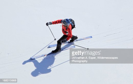 Treetop aerial view of cross country skier on snow