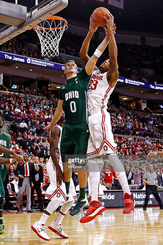 Treg Setty #0 of the Ohio Bobcats attempts to block a shot by Amir Williams #23 of the Ohio State Buckeyes during the second half at Value City Arena on November 12, 2013 in Columbus, Ohio. Ohio State defeated Ohio 79-69.