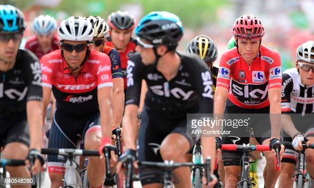 Trek Segafredo's Spanish Alberto Contador and Sky's British Christopher Froome cross the finish line of the 10th stage during the 72nd edition of 'La...