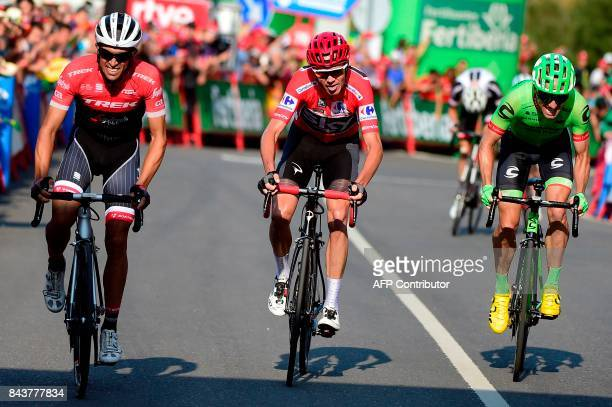Trek Segafredo's Spanish cyclist Alberto Contador and Sky's British cyclist Christopher Froome arrive side by side to cross the finish line of the...