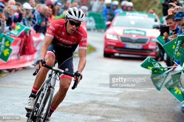 Trek Segafredo's Spanish cyclist Alberto Contador crosses the finish line of the 17th stage of the 72nd edition of 'La Vuelta' Tour of Spain cycling...