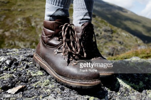 treking shoes standing on solid ground : Stock Photo
