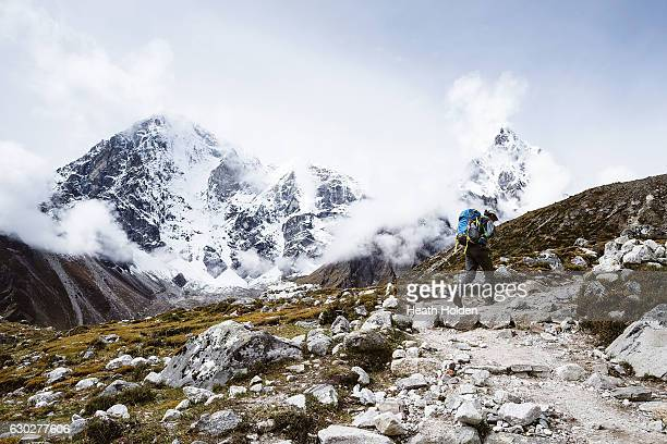 A trekker climbs Dughla / Thukla up the Khumbu valley on September 28 2016 in Dughla Nepal The trails in the SoluKhumbu region of Nepal are stunning...
