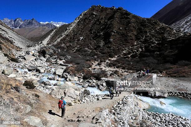 Trekkers in the Imja Khola river valley, Dingboche