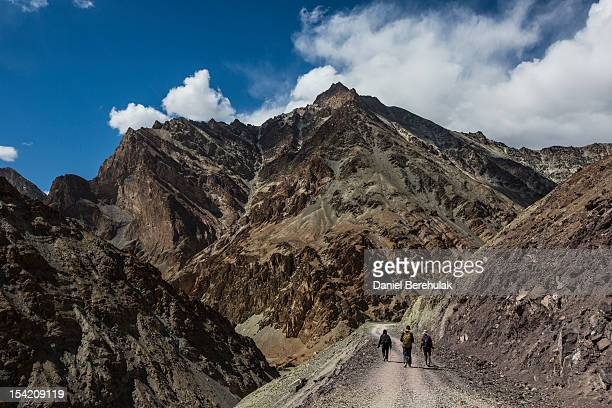 Trekkers make the route between Jingchen to Chilling with views of the Zanskar range on October 9 2012 near to Leh in Ladakh India Ladakh nestled...