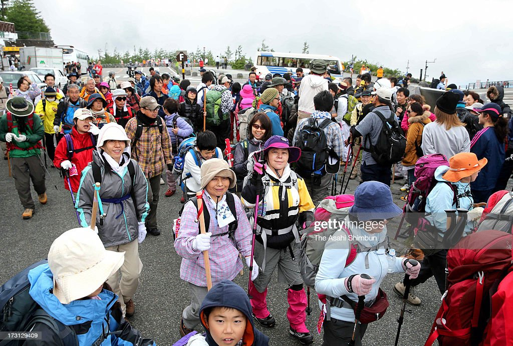 Trekkers prepare to climb Mt. Fuji at its fifth station on July 6, 2013 in Fujiyoshida, Yamanashi, Japan. Mt. Fuji climbing season is until the end of August, expects to attract more climbers than usual as the mountain was registered as an UNESCO World Heritage site.