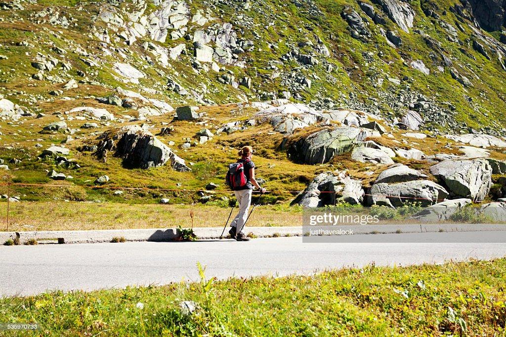 Trekking adult woman on St. Gottard : Stock Photo