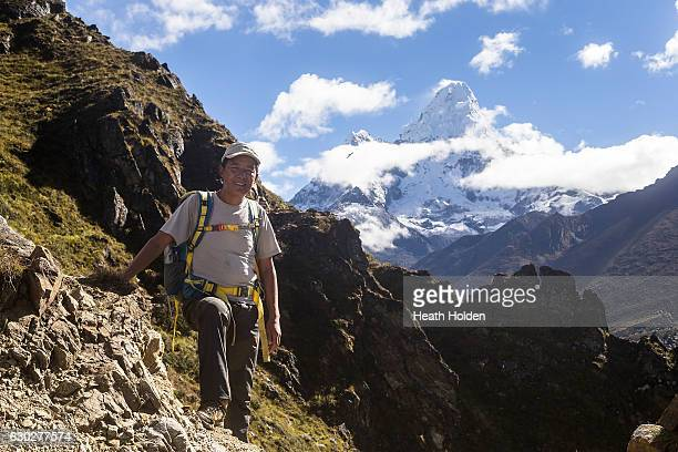 Trekking guide Sange Sherpa in front of Ama Dablam one of the mountains he has summited on September 27 2016 in Phortse Nepal The trails in the...
