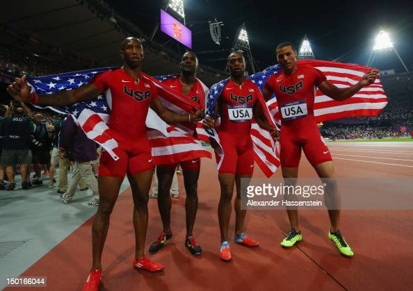 Trell Kimmons Justin Gatlin Tyson Gay and Ryan Bailey of the United States celebrate winning silve during the Men's 4 x 100m Relay Final on Day 15 of...