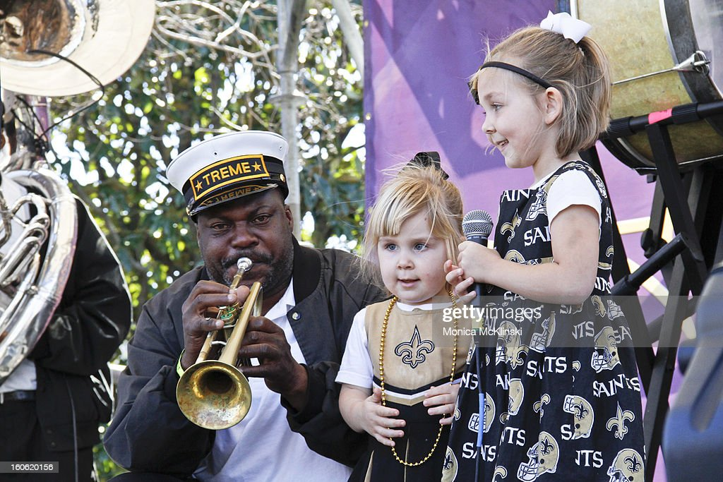 Treme Brass Band trumpeter Kenneth Terry performs with young fans Olivia and Adelaide during the Verizon Super Bowl Boulevard at Woldenberg Park on February 3, 2013 in New Orleans, Louisiana.