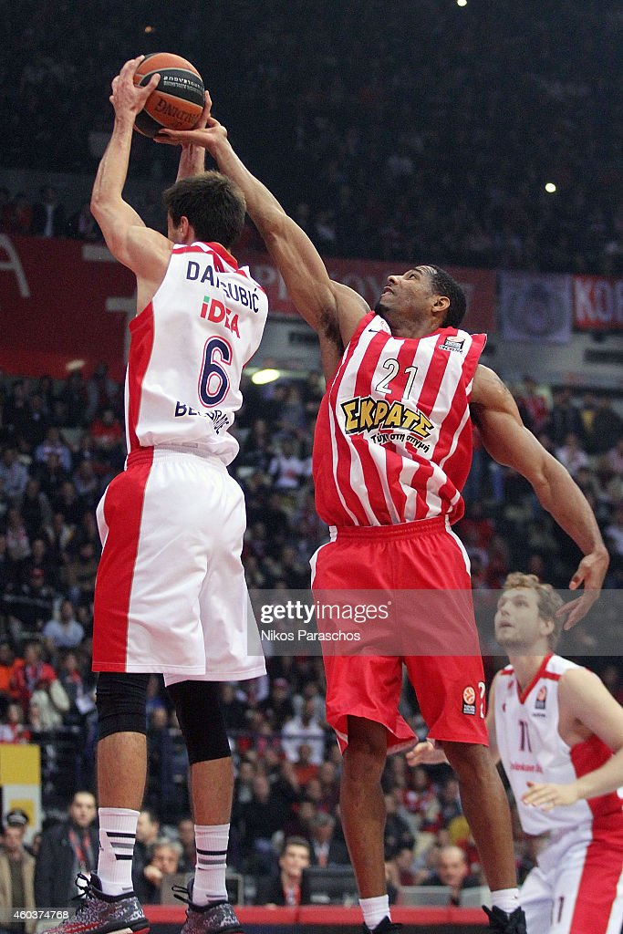 Tremmell Darden, #21 of Olympiacos Piraeus competes with Nemanja Dangubic, #6 of Crvena Zvezda Telekom Belgrade during the 2014-2015 Turkish Airlines Euroleague Basketball Regular Season Date 9 game between Olympiacos Piraeus v Crvena Zvezda Telekom Belgrade at Peace and Friendship Stadium on December 12, 2014 in Athens, Greece.