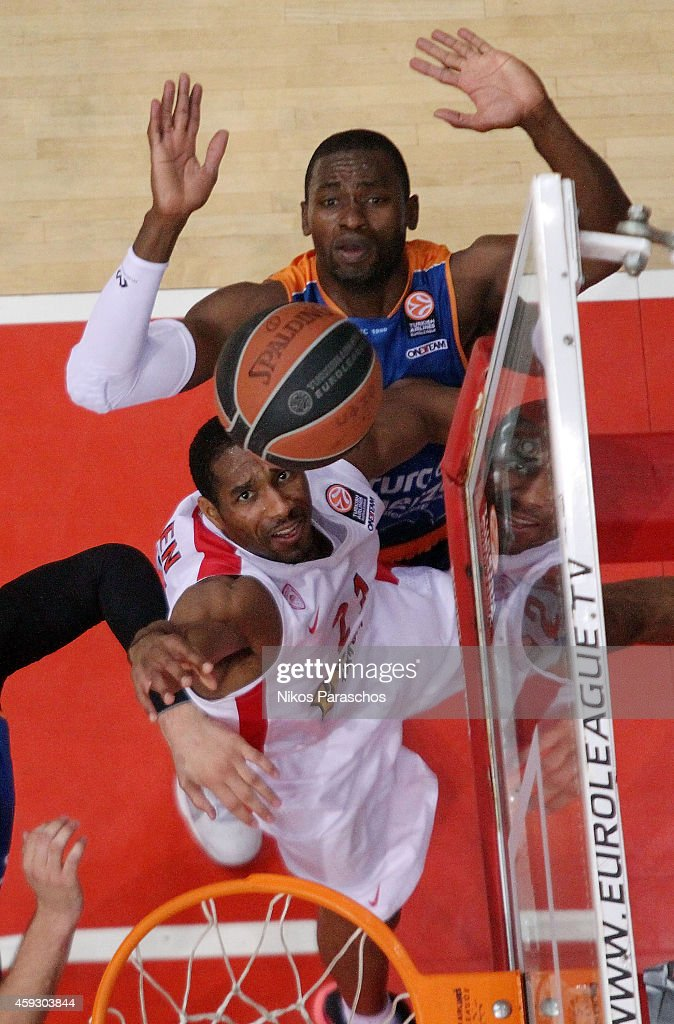 Tremmell Darden, #21 of Olympiacos Piraeus competes with <a gi-track='captionPersonalityLinkClicked' href=/galleries/search?phrase=Romain+Sato&family=editorial&specificpeople=220873 ng-click='$event.stopPropagation()'>Romain Sato</a>, #10 of Valencia Basket during the 2014-2015 Turkish Airlines Euroleague Basketball Regular Season Date 6 game between Olympiacos Piraeus v Valencia Basket at Peace and Friendship Stadium on November 20, 2014 in Athens, Greece.