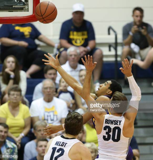 Tremont Waters of the LSU Tigers shoots around Andrew Rowsey of the Marquette Golden Eagles during the first half of their game at the Maui...