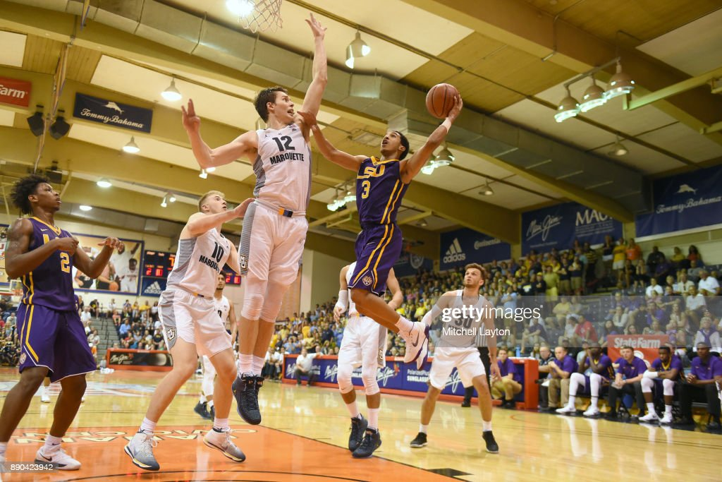 Tremont Waters #3 of the LSU Tigers tries to take a shot Matt Heldt #12 of the Marquette Golden Eagles during a consultation college basketball game at the Maui Invitational at the Lahaina Civic Center on November 22, 2017 in Lahaina, Hawaii. The Golden Eagles won 94-84.
