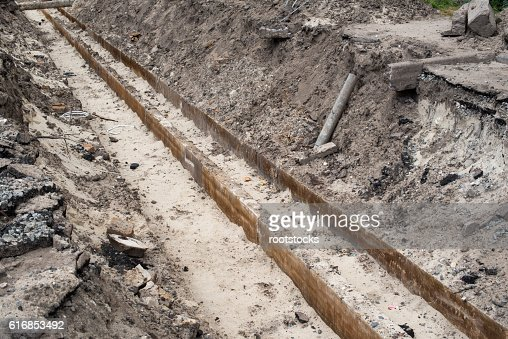 Trench for utility lines : Stock Photo