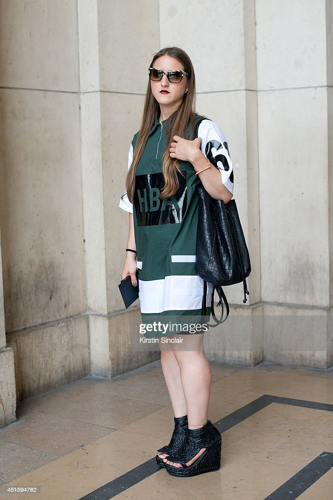 Trend forecaster Dani Marino wearing a Hood By Air shirt, Kurt Geiger bag, Persol sunglasses and KTZ shoes on day 2 of Paris Collections: Men on June 26, 2014 in Paris, France.