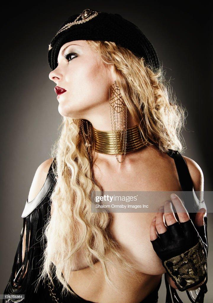 Trendy Caucasian woman covering breast : Stock Photo
