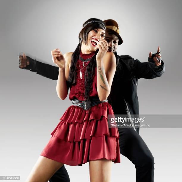 Trendy couple dancing