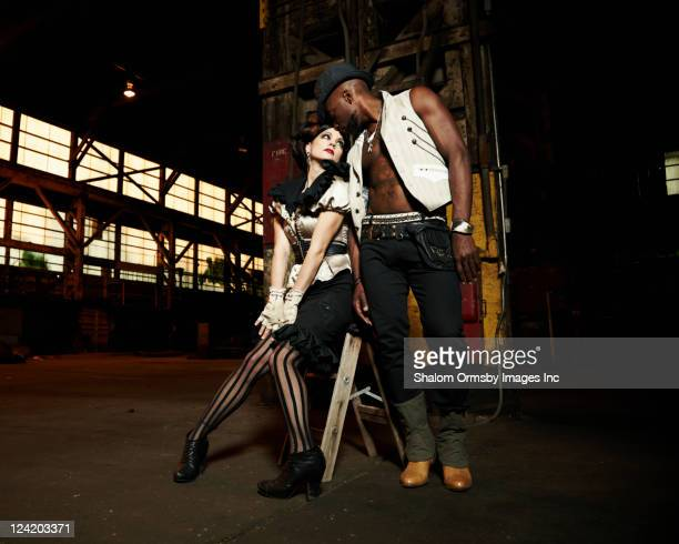 Trendy couple in warehouse