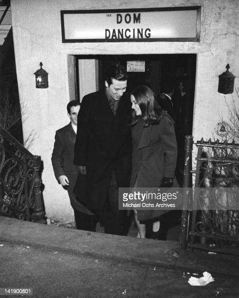 A trendy couple leaves the hot East Village night spot called 'The Dom' in 1960 in New York New York
